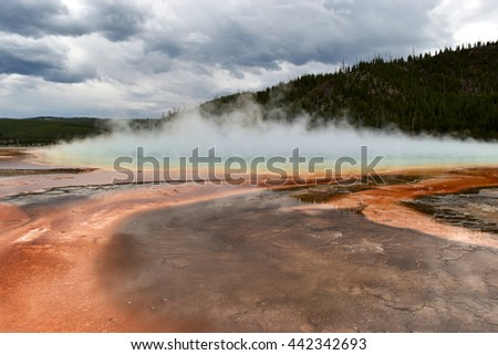 Foggy, rust colored prismatic lake landscape with cloud covering - stock photo