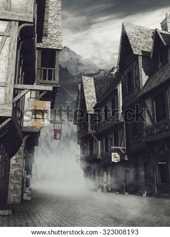 Foggy street with medieval buildings in the mountains - stock photo