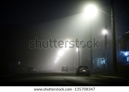 Foggy street with nobody in the suburb - stock photo