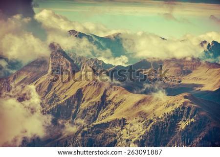Foggy summer morning in the Italian Alps. National Park. Dolomites, South Tyrol. Location Canazei, Campitello, Mazzin. Italy, Europe. Retro style. - stock photo