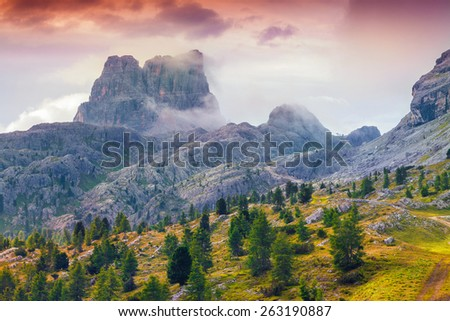 Foggy summer morning on the Cinque Torri mountain. View from Falzarego pass. Dolomites mountains, Alps, Italy, Europe. - stock photo