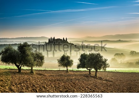 Foggy valley in the Tuscany, Italy - stock photo