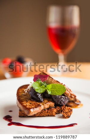 foie gras and glass of wine - stock photo