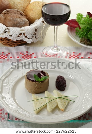 Foie gras pate with toasts and cranberry jelly/ Goose liver pate - stock photo