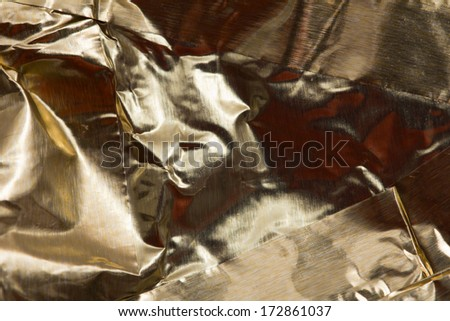 foil background with orange highlights - stock photo