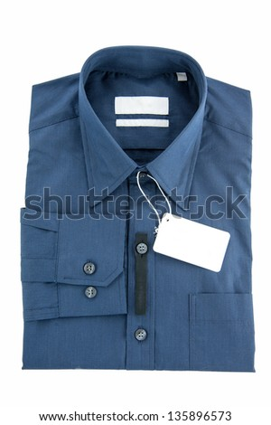 Fold long sleeves shirt with price tag - stock photo