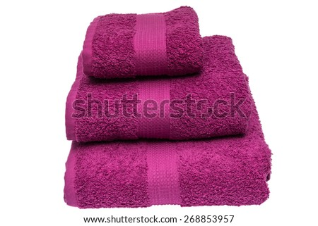Folded bath towels on white background - stock photo