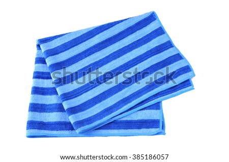 Folded Beach Towel. Towel striped cloth set isolated on white background. - stock photo