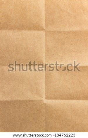 folded brown paper as texture - stock photo