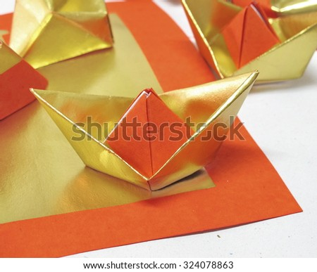 Folded Chinese gold paper, use for make a sacrifice to gods - stock photo