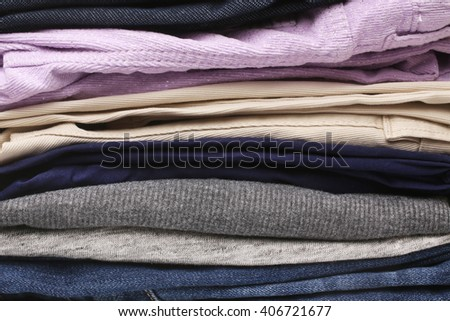 Folded clothes, for backgrounds or textures - stock photo