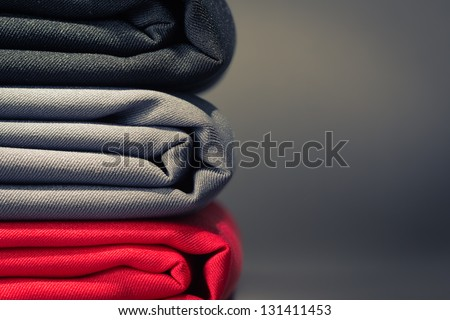 Folded cloths stack with space for text - stock photo