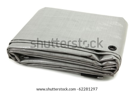 Folded Gray Tarp Isolated Over White - stock photo
