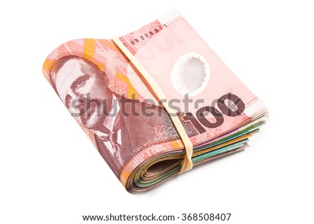 folded hundred dollar bills in New Zealand currency - stock photo