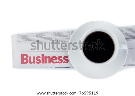 Folded newspaper and cup of coffee on a white background - stock photo