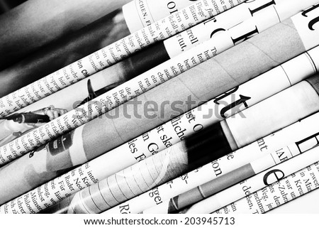 Folded newspapers background - stock photo