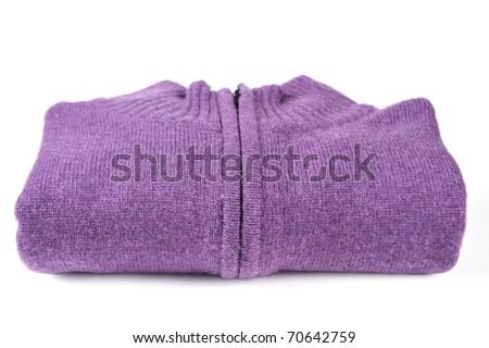 Folded purple sweater isolated on white - stock photo