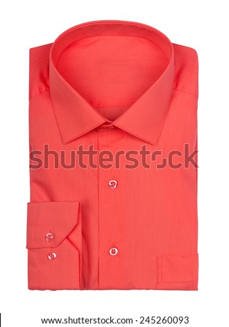 folded red shirt on a white background - stock photo