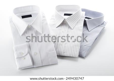 folded shirt on  white background - stock photo