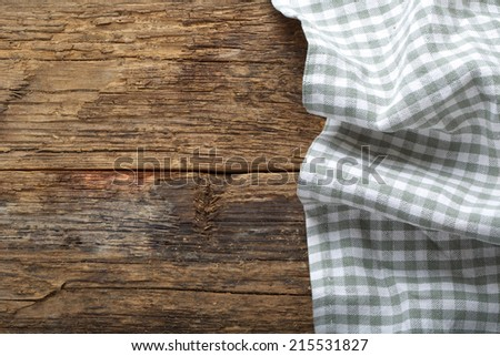 folded tablecloth on wooden table  - stock photo