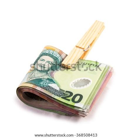 folded twenty dollar bills in New Zealand currency - stock photo