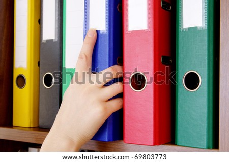 Folder with archival documents and a hand - stock photo