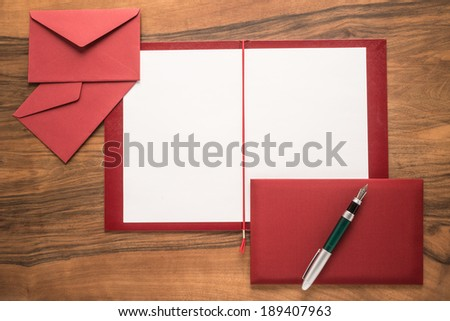 Folder with paper on wooden background - stock photo