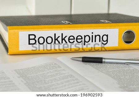 Folder with the label Bookkeeping - stock photo