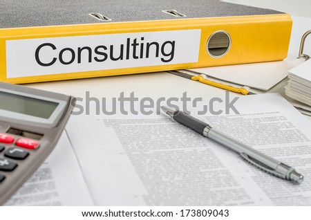 Folder with the label Consulting - stock photo