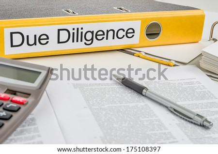 Folder with the label Due Diligence - stock photo