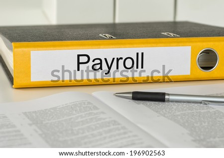 Folder with the label Payroll - stock photo