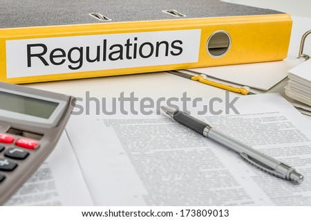 Folder with the label Regulations - stock photo