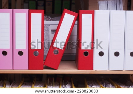 Folders on shelf - stock photo