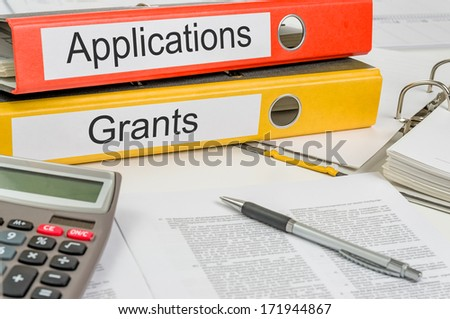 Folders with the label Applications and Grants - stock photo