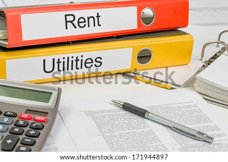 Folders with the label Rent and Utilities - stock photo