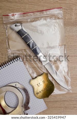 Folding knife crime scene - evidence and marshal's character. - stock photo