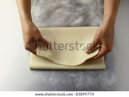 Folding the pastry - stock photo