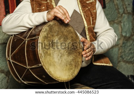 Folk musician plays the dhol - stock photo
