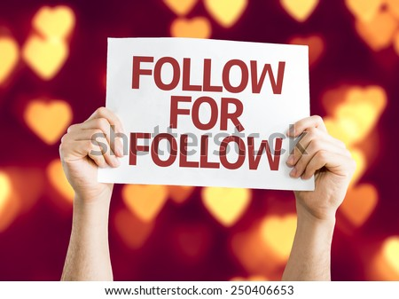 Follow for Follow card with heart bokeh background - stock photo