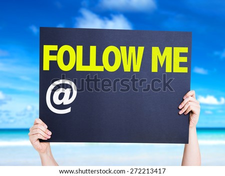 Follow Me with a copy space card with beach background - stock photo