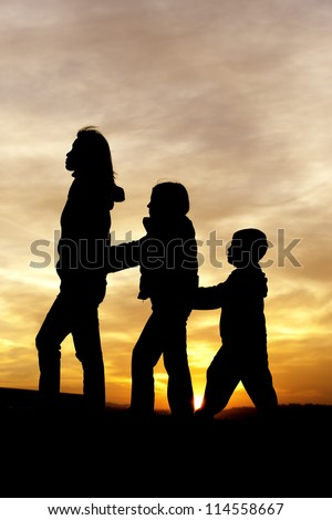 Follow the leader at sunset. - stock photo