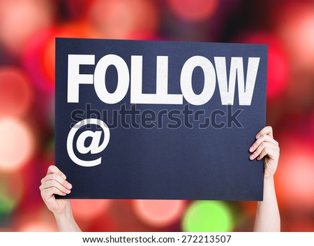 Follow with a copy space card with bokeh background - stock photo