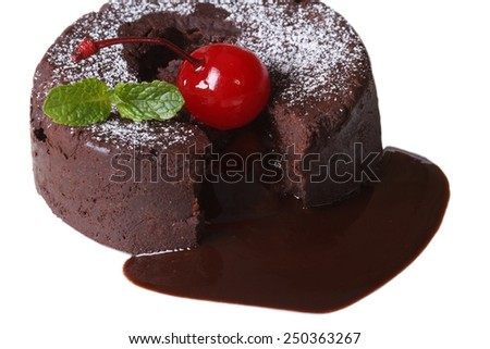 fondant chocolate cake with cherries and mint closeup isolated on white background  - stock photo