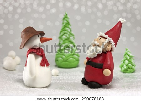 Fondant snowman and santa - stock photo