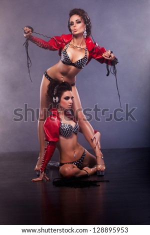 Fondness. Couple Sexy Girls Lesbians - Role Play. Flirtation. Series of photos - stock photo