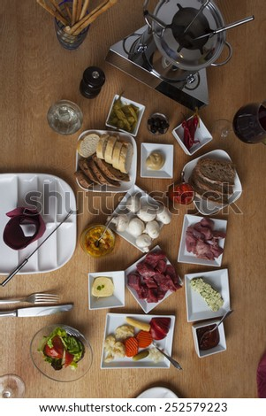 fondue on a table seen from the top  - stock photo