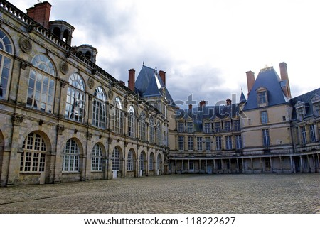 FONTAINEBLEAU, FRANCE: Palace of Fontainebleau is one of the largest French royal chaÃ?Â??teaux. The palace is the work of many French monarchs, building on an early 16th century structure of Francis I - stock photo