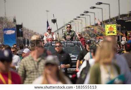 FONTANA, CA - MAR 23: Dale Earnhardt Jr (left) and Kyle Busch at the Nascar Sprint Cup Auto Club 400 race at Auto Club Speedway in Fontana, CA on March 23, 2014 - stock photo