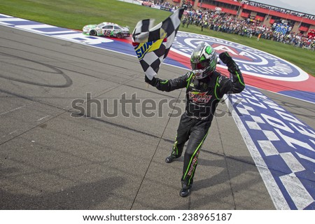 "Fontana, CA - Mar 23, 2014:  Kyle Busch (18) wins the ""Auto Club 400"" at Auto Club Speedway in Fontana, CA. - stock photo"