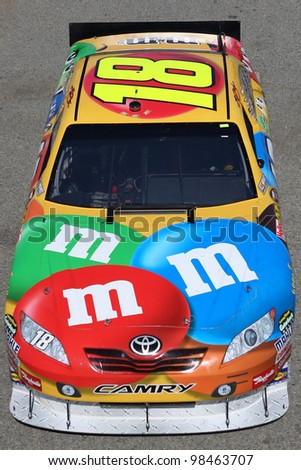 FONTANA, CA. - OCT 9: Sprint Cup Series driver Kyle Busch in the M&M's #18 car during the Pepsi Max 400 practice on Oct 9 2010 at the Auto Club Speedway. - stock photo